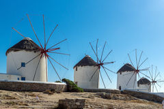 Panoramic view of white windmills and blue sky on the island of Mykonos, Greece Stock Images