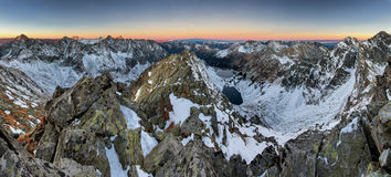 Panoramic view of white winter mountains with colorful sunset - royalty free stock images