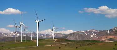 Panoramic view on wind farm stock images