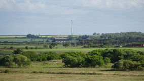 Panoramic view with wind turbine in the middle Stock Image