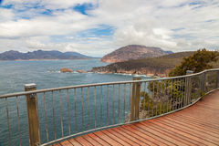 Wineglass Bay. Panoramic view of Wineglass Bay from the wooden walkway that leads up to Cape Tourville Lighthouse within the Freycinet Peninsula. The Freycinet Stock Photography