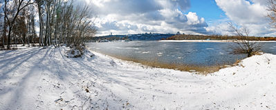 Panoramic view of winter landscape. With frozen river and trees covered with snow Royalty Free Stock Photography