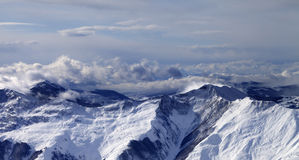 Panoramic view on winter mountains in clouds Stock Image