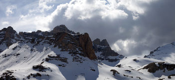 Panoramic view on winter mountains in storm clouds Royalty Free Stock Photos