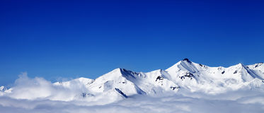 Panoramic view of winter snowy mountains under clouds at nice da Royalty Free Stock Image