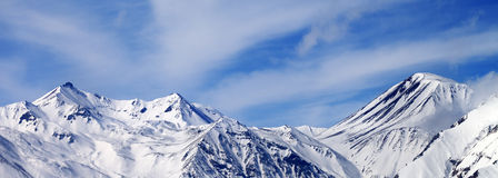 Panoramic view on winter snowy mountains in windy day Stock Photo