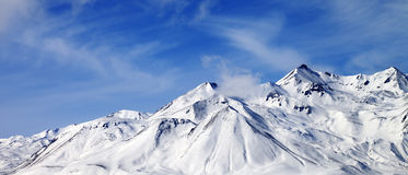 Panoramic view of winter snowy mountains at windy day Stock Photography