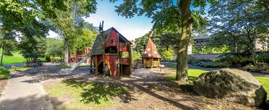 Panoramic view of wooden playground with magic houses and slide in Duthie park, Aberdeen royalty free stock photo