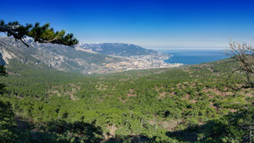 """Panoramic view of Yalta city, pine woods and Black sea from the """"Silver arbor"""" observatory. Panoramic view of Yalta city, pine woods and Black sea Royalty Free Stock Photos"""
