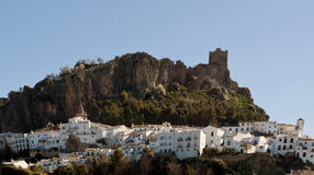 Panoramic view of Zahara. A massive landscape surrounded by trees, in the village of Zahara de la sierra in Spain. You can see some white house and a castle in Stock Photography