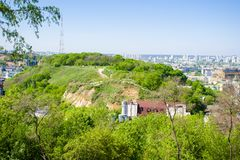 Panoramic view of the Zamkova Hora Castle Hill or mount in Kyiv covered with greenery. In the background cityscape of Podil and. Obolon districts against the stock image