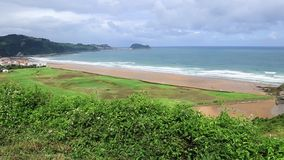 Panoramic view of Zarautz with Guetaria on the background on a bright sunny summer day. Stock Photography