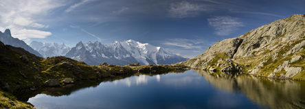 Panoramic views of French Alps. Blue lake and mountain range of Tour de Mont Blanc, French Alps Royalty Free Stock Image
