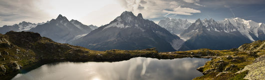 Panoramic views of French Alps. Lake and mountain range of Tour de Mont Blan (situated in the Aiguille Rouge near Chamonix, France Royalty Free Stock Photo