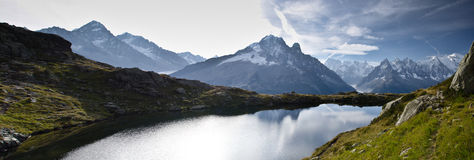 Panoramic views of French Alps. Lake and mountain range of Tour de Mont Blan (situated in the Aiguille Rouge near Chamonix, France Stock Image