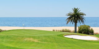 Panoramic views of the golf course to the sea and palm trees. Royalty Free Stock Images
