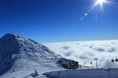 Panoramic views of the mountains. Snowy mountains covered with clouds clear day Stock Photo