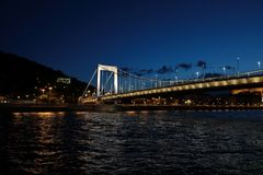 Panoramic views of night bridges through Danube with illumination. Massive support of bridges I create the special atmosphere stock image