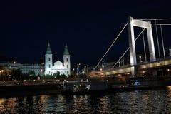 Panoramic views of night bridges through Danube with illumination. Massive support of bridges I create the special atmosphere stock photo