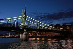 Panoramic views of night bridges through Danube with illumination. Massive support of bridges I create the special atmosphere royalty free stock images