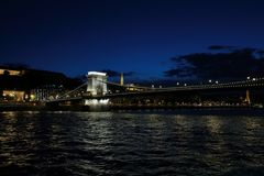 Panoramic views of night bridges through Danube with illumination. Massive support of bridges I create the special atmosphere royalty free stock photography