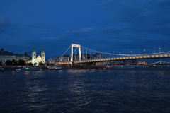 Panoramic views of night bridges through Danube with illumination. Massive support of bridges I create the special atmosphere royalty free stock image