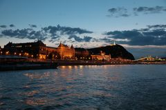 Panoramic views of night bridges through Danube with illumination. Massive support of bridges I create the special atmosphere stock photography