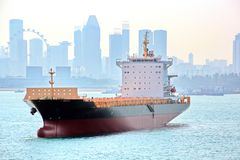 Panoramic views of the port and the city of Singapore during day and night. Kind of cargo and merchant vessels anchored. royalty free stock images