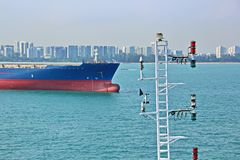 Panoramic views of the port and the city of Singapore during day and night. Kind of cargo and merchant vessels anchored. royalty free stock image