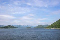 Panoramic views of reservoir,hills and blue sky at Kaeng Krachan Dam,Kaeng Krachan National Park,Phetchaburi Province, Thailand. Stock Photo