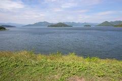 Panoramic views of reservoir,hills and blue sky at Kaeng Krachan Dam,Kaeng Krachan National Park,Phetchaburi Province, Thailand. Stock Photos