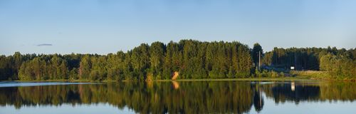 Panoramic views of the river and  forest on the banks. Panoramic views of the river and the forest on the banks Royalty Free Stock Image