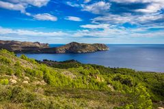 Panoramic views of the sea and mountains, rocky and hilly terrain on the coast of Costa Brava, the Mediterranean Sea in Spain, Cat royalty free stock image