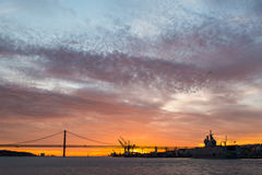 Panoramic views of the Tagus River, Bridge April 25 Lisbon and  port at sunset from ship, Portugal. Royalty Free Stock Image