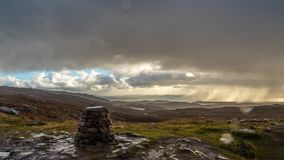 Panoramic views from the top of Bealach na Bà. Panoramic views over Ramsay, Rona and Skye from top of Bealach na Bà. Rain, mountains, heather, stormy skies stock photos