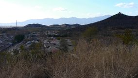 Panoramic of village grass mountains in autumn,Altocumulus cloud in blue sky. stock video