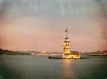 Panoramic vintage photo of Maiden's Tower (Kiz Kulesi) at night Royalty Free Stock Photos
