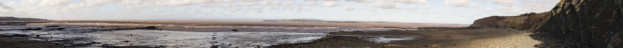 Bay of Fundy and Joggins Fossil Cliffs, Nova Scotia, Canada. Panoramic vista of Bay of Fundy at low tide at World Heritage SIte Joggins Fossil Cliffs, Nova stock photo