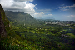 Panoramic Vista from the Pali Lookout in Oahu, Hawaii. The stunning green and blue of a tropical paradise cascades away from the mountains in Oahu, Hawaii as Stock Photos