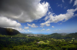 Panoramic Vista from the Pali Lookout in Oahu, Hawaii. The stunning green and blue of a tropical paradise cascades away from the mountains in Oahu, Hawaii as Stock Images