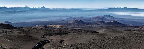 Panoramic volcano landscape of Kamchatka Peninsula: series of cinder cones and lava fields stock images