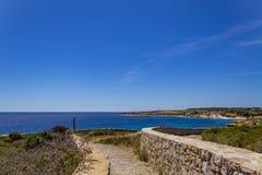 Panoramic walkway near Carloforte Island of San Pietro, Carboni. View of the walkway overlooking the sea and the coast near Carloforte Island of San Pietro Stock Photo