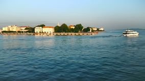 Panoramic waterfront view of Zadar, Croatia from a boats perspective. With old town, harbor and the famous sea organ stock footage
