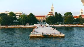 Panoramic waterfront view of Zadar, Croatia from a boats perspective. Before landing at pier, church of St. Donatus in background stock video footage