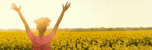 Mixed race African American girl female young woman athlete runner teenager celebratimg at golden sunset stock photo