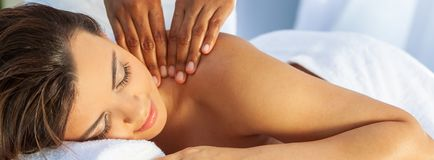 Woman At Health Spa Having Relaxing Outdoor Massage Panorama stock images