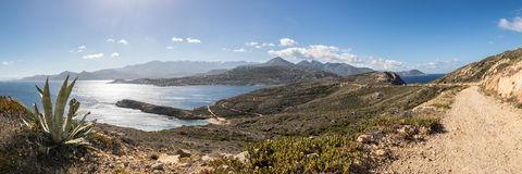 Panoramic of west coast and mountains from Revellata in Corsica Royalty Free Stock Image