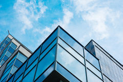 Panoramic wide angle view to steel blue background of glass high rise building skyscrapers in modern futuristic downtown Royalty Free Stock Photo