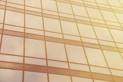 Panoramic wide angle view to steel light gold background of glass high rise building skyscraper commercial modern city Stock Photos