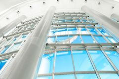 Panoramic windows and columns of the shopping center. Bottom view stock photo